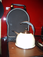 © Martine Moeykens -2007- The new cream coloured Aga whistle kettle to boil water on 'Ruby'-